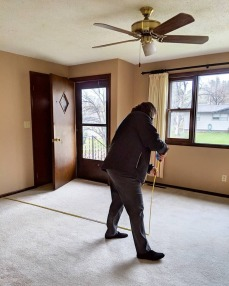 Measuring for the hardwood floors.